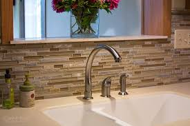 white ceramic sink and sleek faucet for amazing kitchen ideas with decorative glass mosaic tile backsplash