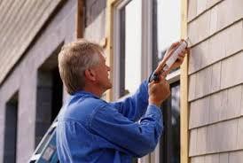 exterior window trim install. trim and seal new windows with exterior casings. window install