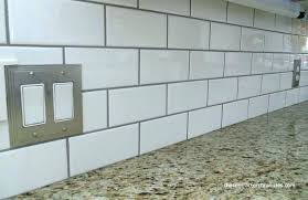 rare white kitchen with an industrial touch white tiles black grout white subway tile with light