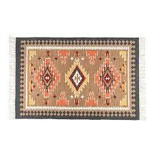 homescapes jakarta handwoven kilim wool rug pink orange yellow multi coloured geometric pattern wool