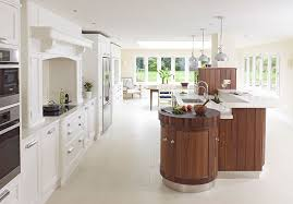 this rencraft island unit features stainless steel plinths curved cupboards and chopping board s for kitchen furniture start from 18 000