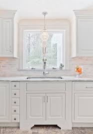 over kitchen sink lighting. Over Kitchen Sink Lighting Traditional With Marble Countertop Floor