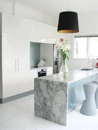 Dramatic marble slab with a waterfall edge for this custom kitchen ...