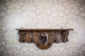 coat rack with a mirror circa the turn of the 19th and 20th centuries