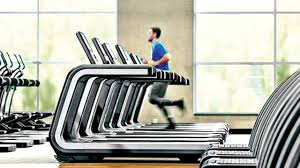 a man runs on a treadmill one of many with large high tech