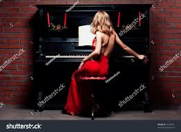 lady red dress playing piano painting