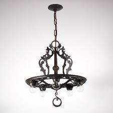striking antique tudor five light cast iron chandelier c 1920 s nc1216 for