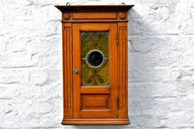 antique wall cabinet with brand stained
