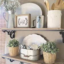 Kitchen wall decorating ideas Hanging Rustic Kitchen Plant And Utensil Display Homebnc 36 Best Kitchen Wall Decor Ideas And Designs For 2019