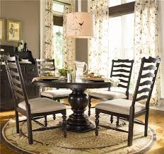 round dining table w 4 ladder back side chairs