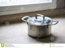 Old Aluminum Stainless Steel Cooking Pot On Kitchen Table Stock