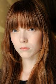 model with light brown hair and a soft round fringe