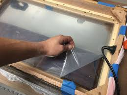 i removed the outer protective from the mirror and set the mirror into place since the mirror material is 1 8 you can also order thicker material