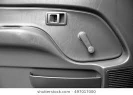 car door inside with door handle and manual door window regulator