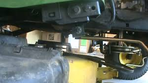 how to remove the deck and the blades on your jonh deere  how to remove the deck and the blades on your jonh deere 100 series tractor