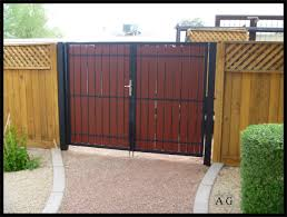 well liked wooden fences added brown finished diy wooden driveway gates also stones pavers as well as green plants for natural front yard decors