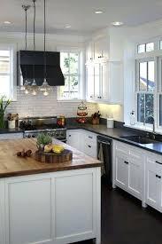 white cabinets with black granite white cabinets