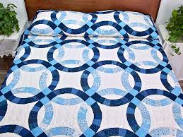 Double Wedding Ring Quilt -- outstanding adeptly made Amish Quilts ... & Navy Blue and Cream Double Wedding Ring Quilt Photo 1 ... Adamdwight.com