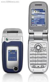 sony ericsson flip phone 2005. decent phone that was $50 with plan. came in lambo orange too lol. also played music and had an expandable microsd slot. sony ericsson flip 2005
