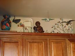 Above Kitchen Cabinet Kitchen Decorating Above Kitchen Cabinets By Adding The Fresh