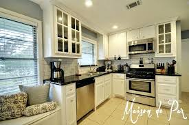 off white cabinets with granite countertops off white kitchen cabinets with black black granite we chose