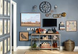 gallery wall accented with dark blue gray