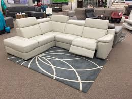 The Ashlynn Sectional just arrived at Sofa Land! This 100% leather piece  features one