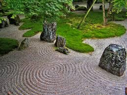 The Japanese rock garden or zen garden, creates a miniature stylized  landscape through carefully composed