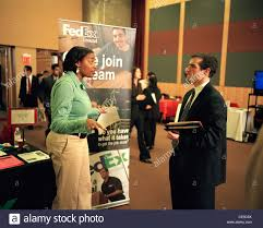 students college graduates and adults seek job opportunities from stock photo students college graduates and adults seek job opportunities from corporations at a career day job fair at rutgers university