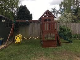 backyard discovery atlantis swing set 3 swings slide mini climbing wall and playhouse