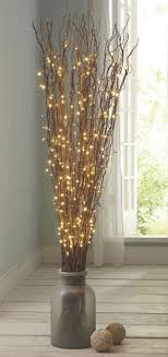 Fill a substantial floor vase with a tall arrangement of LED branches. It's  another beautiful
