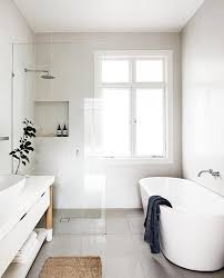 modern white bathroom designs. Modren White Minimalist Bathroom With A Standing Tub And Glass Shower Intended Modern White Bathroom Designs L