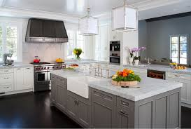 Dusty Grey Custom Kitchen Cabinet With White Marble Countertop And Square  Pendant Lighting Fixtures And A White Sink On The Island