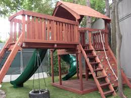 redwood fort with bridge cargo rope climb rock wall tire swing 14
