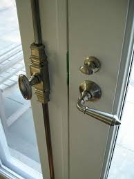 this is a typical french type installation of a cremone bolt they often were used to hold the inactive door closed and the active door was