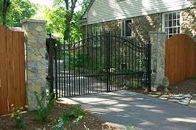 fence next to driveway. driveway gate with fence next to