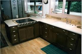 cream kitchen cabinets with dark floors