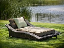 large grey rattan wicker outdoor patio chaise lounge with brown mattres and cushion placed on green lawn grass adorable oversized chaise lounge chair