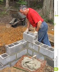 man-laying-concrete-block-wall-6593448.jpg (10651300) | showers |  Pinterest | Block wall, Concrete and Outdoor projects