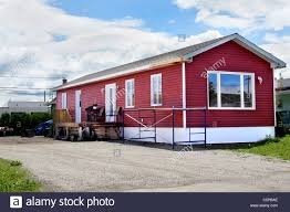 newly constructed red vinyl siding mobile home at the local trailer park n94