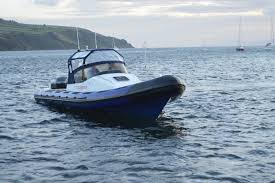 the elements and can be removed to give an open boat feel its fitted with 6 single pod seats and a long rear bench back seat with room for 5 people