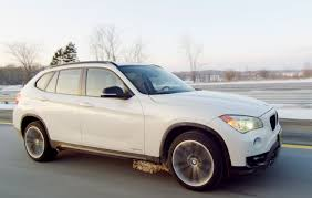 All BMW Models 2013 bmw x1 ground clearance : 2013 BMW X1 xDrive28i - Review - CAR and DRIVER - YouTube