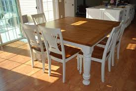 easy diy modern square farmhouse dining table with oak top and wooden base painted with white color for 8 chairs beside glass sliding door ideas