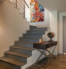 ... Colorful artwork at stairwell landing brightens the area