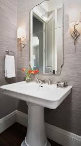 powder room lighting. Gray Powder Room Features Walls Clad In Sisal Wallpaper Lined With A Curved Chrome Mirror Lighting