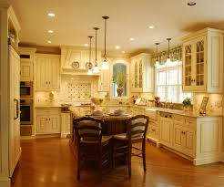 traditional kitchen lighting ideas. kitchen stunning design ideas of traditional with cream color cabinets and combine rectangle shape brown island also wooden lighting w