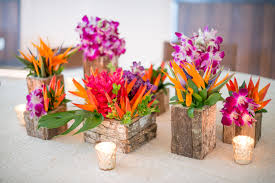 Tropical flower arrangements. Rustic wood vases with opal, bird of  paradise, ginger and