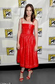 ruth wilson dazzles in red patent leather midi dress as she speaks on his dark materials panel