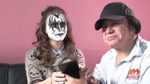 in a video by cosmopolitan kiss co frontman gene simmons demonstrates how to put on his iconic demon makeup by applying it to his daughter sophie tweed