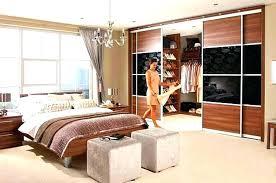master bedroom closet behind bed bed master bedroom with closet behind bed